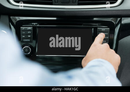 blank navigation screen on dashboard inside a car - Stock Photo