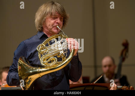 Russian horn player, composer, arranger, improviser Arkady Shilkloper acts with a large symphony orchestra in Moscow - Stock Photo