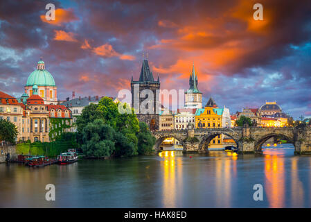 Vibrant stormy sunset sky over the River Vltava and Charles Bridge Prague Czech Republic Europe - Stock Photo