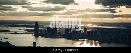 Lower Manhattan sunset from Empire State Building - Stock Photo