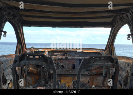 burned down car wreck - damaged car - Stock Photo