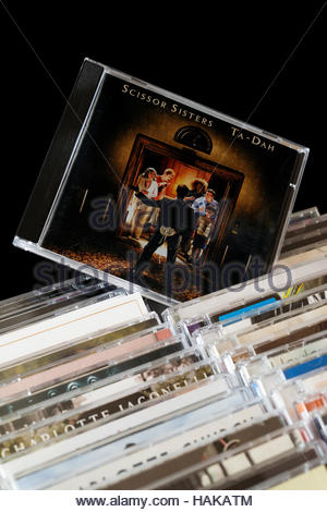 Ta-Dah, Scissor Sisters 2nd CD pulled out from among rows of other CD's - Stock Photo