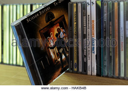 Ta-Dah, Scissor Sisters 2nd CD pulled out from among other CD's on a shelf - Stock Photo