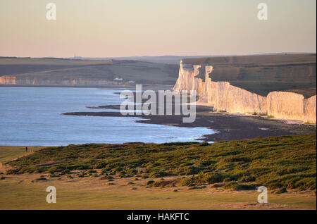 Chalk cliffs of the Seven Sisters where the South Downs meets the sea - Stock Photo