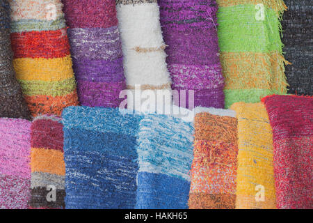 Freshly dyed skeins of wool hang drying in the sunlight - Stock Photo