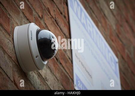 mounted on a church building CCTV cameras hidden on wall - Stock Photo