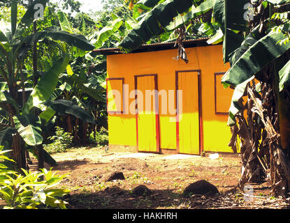 zinc sheet metal house in jungle with laundry drying Quinn Hill Big Corn Island Nicaragua Central America - Stock Photo