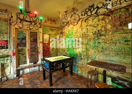 Szimpla Kert (Simple Garden, Budapest, Kazinczy street 14.) is the pioneer of Budapest ruin pubs. - Stock Photo