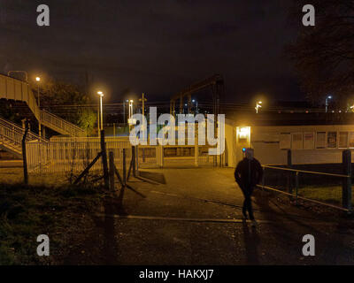 drumry railway station scotrail at night Lone person in the dark - Stock Photo