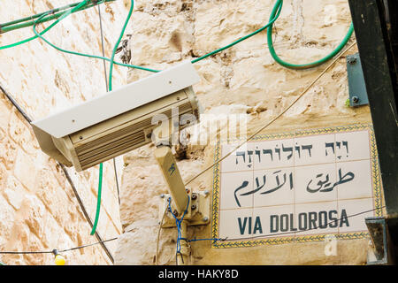 A security camera and a street sign of Via Dolorosa, in the old city of Jerusalem, Israel - Stock Photo