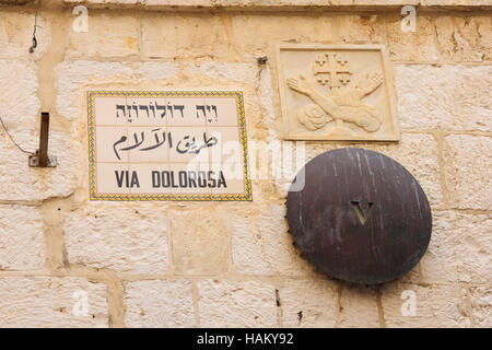 A mark of station 5 of the Via Dolorosa, and a street sign, in the old city of Jerusalem, Israel - Stock Photo