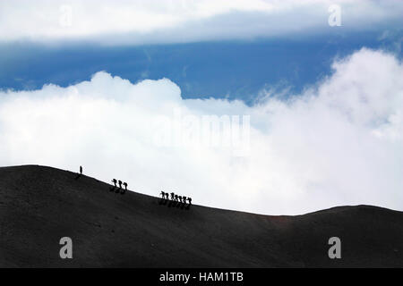 people excursion to volcano Mount Etna - Stock Photo