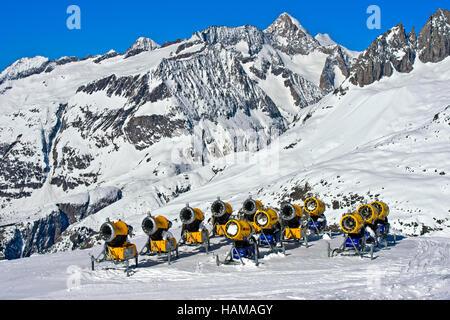 Snow cannons on ski slope, Aletsch Arena ski resort, Bettmeralp, Valais Canton, Switzerland - Stock Photo