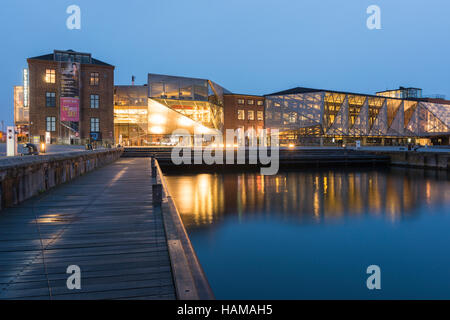 View at dusk of The Culture Yard, a modern cultural center with library, designed by AART architects in Elsinore - Stock Photo