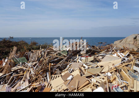 Dumping ground for discarded wood on the coast of Öckerö island, Bohuslan, Sweden - Stock Photo