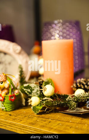 Christmas arrangement of candles tree branches picture frames and boxes toys - Stock Photo