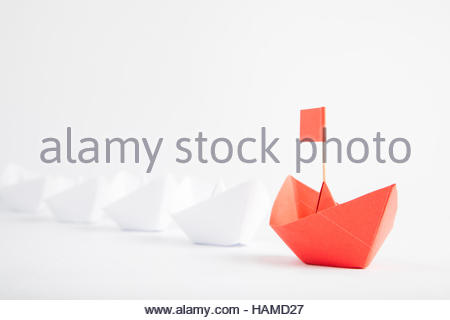 Red Boat Leadership Concept on White Background - Stock Photo