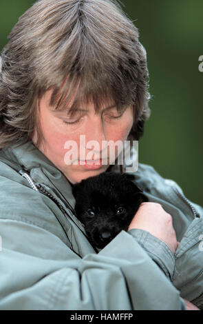 Woman with puppy / Frau mit Welpe - Stock Photo