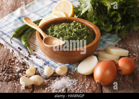 South American cuisine: chimichurri sauce and ingredients close-up on the table. horizontal - Stock Photo