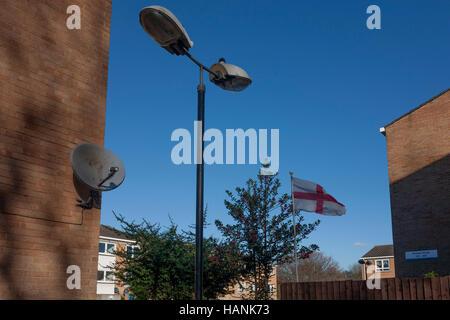 The English flag flies in a garden on a hosing estate, on 28th November 2016, near Camberwell, south London borough - Stock Photo
