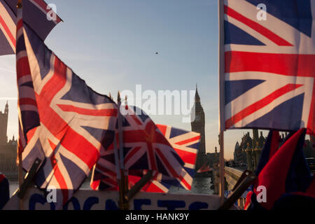 British union jack flags are in the foreground with Big Ben and the Houses of Parliament in the distance, on 30th - Stock Photo