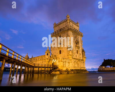 Torre de Belem on the bank of Tagus river in Lisbon, Portugal, at night. - Stock Photo