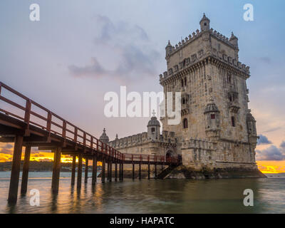 Torre de Belem on the bank of Tagus river in Lisbon, Portugal, at sunset. - Stock Photo
