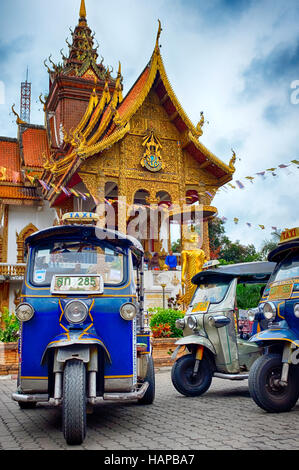 Tuk-tuk in front of Wat Buppharam, Chiang Mai, Thailand - Stock Photo