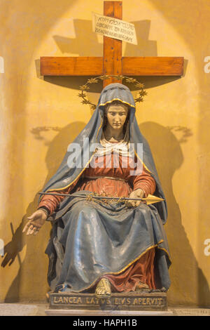 ROME, ITALY - MARCH 12, 2016: The carved statue of Lady of Sorrow with the lance in church Chiesa di Nostra Signora - Stock Photo