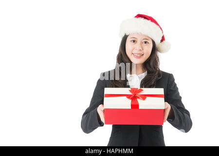 Christmas business woman smiling holding present isolated on white background. Santa girl showing gift wearing Santa - Stock Photo