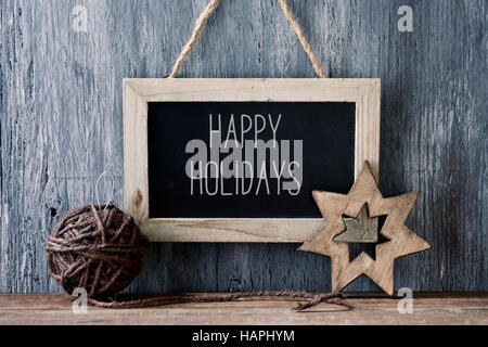 a chalkboard with the text happy holidays written in it a handmade