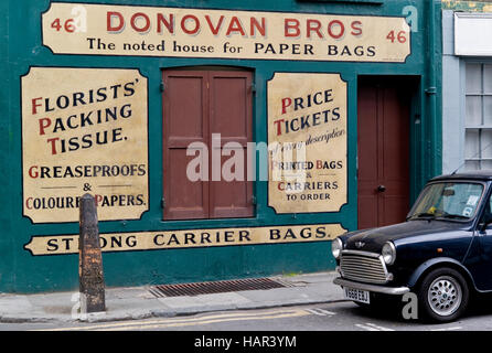 Donovan Brothers paper bags factory and shop now closed based in Crispin Street Spitalfields with an Austin Mini - Stock Photo