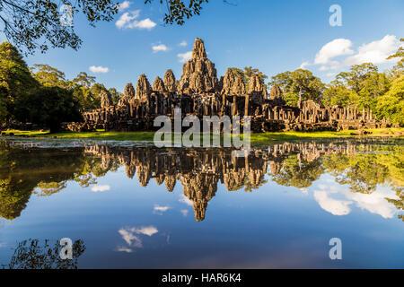 Angkor wat temple reflecting in a glassy lake - Stock Photo