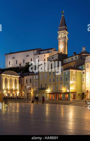 Twilight over St. George's Parish Church and town center (Tartinijev trg), Piran, Primorska, Slovenia - Stock Photo