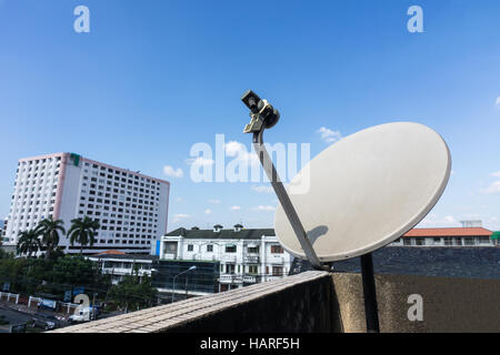 Satellite dishes or satellite antennas mounted on the home. - Stock Photo