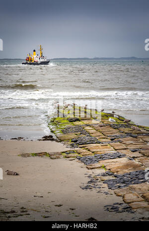 Cobbled feature extending out into the North Sea on a beach on Norderney Island, Germany, Europe. - Stock Photo
