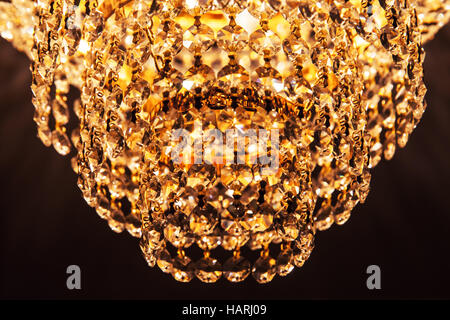 Old Style Round Retro Chandelier With Crystal Glass Design Elements Closeup Photo