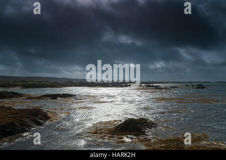 Dark clouds gathering over the Atlantic coast of County Galway, Ireland. - Stock Photo