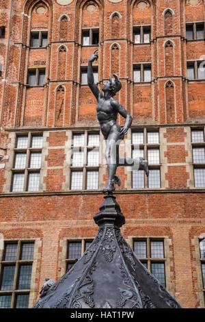 Poland, Pomerania, Gdansk (Danzig), statue of Mercury at Artus Court against the backdrop of the Main City Hall - Stock Photo