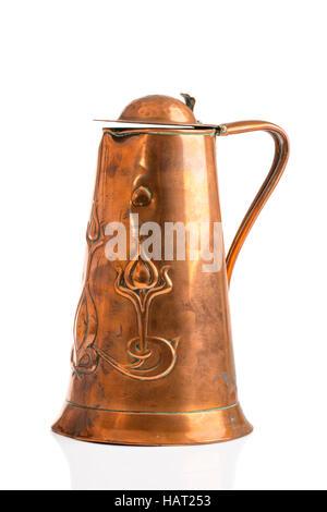 Antique Art Nouveau copper jug on a white background - Stock Photo