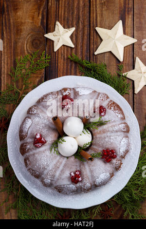 Traditional homemade christmas cake on vintage wooden background. Top view - Stock Photo