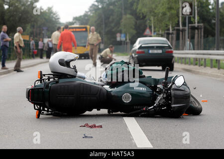 Accident damaged motorbike lying in the road, severe accident involving a motor-cyclist, Pillnitz, Saxony - Stock Photo