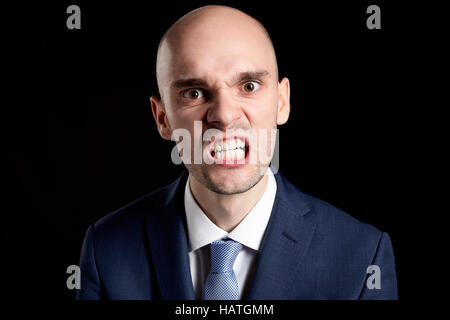 Portrait of Young Angry Guy against Black Background. - Stock Photo