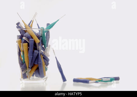 little toothbrushes in a glass - Stock Photo