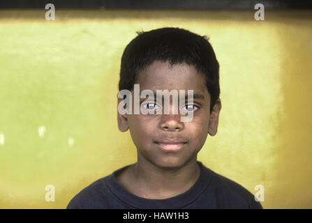 Portrait of young boy with large bright eyes. Asian Indian heritage - Stock Photo