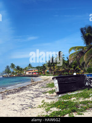 North End Beach Big Corn Island Nicaragua with old boats and hotel in background on Caribbean Sea - Stock Photo