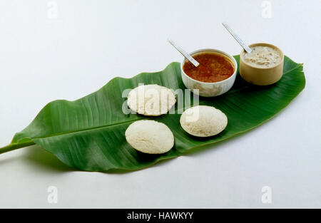 Idli Sambar, chutney on banana leaf.  South Indian snack, India - Stock Photo