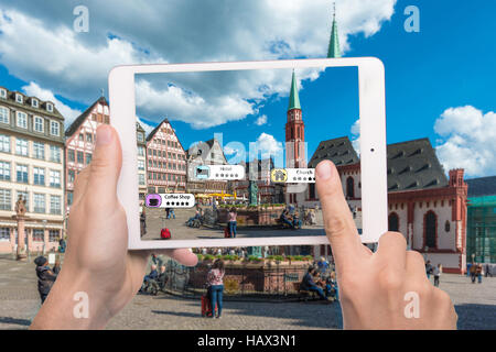 Hand holding smart phone use AR application to check relevant information about the spaces around customer. Augmented - Stock Photo