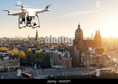 Drone with high resolution digital camera flying over Amsterdam historical city at Amsterdam, Netherlands. - Stock Photo