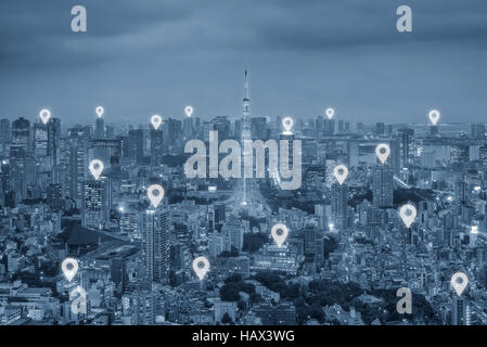 Map pin flat above Tokyo city scape and network connection concept. Tokyo smart city. - Stock Photo